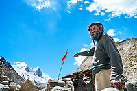 The Shivling trek in the Indian Himalaya starts with a three drive from Delhi to Gangotri, a Hindu holy place along the Ganges River. From Gangotri, a two day walk reaches both the Tapovan or Nandanvan basecamp at the base of Shivling, 6543 meters, and from there numerous trails can be explored. Passing a Sadhu's hut in Gaumukh at the source of the river Ganges where he points to the mountains.