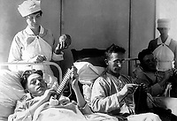 Bed-ridden wounded, knitting.  Walter Reed Hospital, Washington, D.C.  Ca. 1918-19. Harris & Ewing.  (War Dept.)<br />Exact Date Shot Unknown<br />NARA FILE #:  165-WW-265B-17<br />WAR & CONFLICT BOOK #:  674
