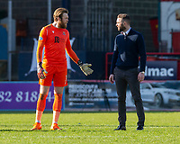 3rd April 2021; Dens Park, Dundee, Scotland; Scottish FA Cup Football, Dundee FC versus St Johnstone; Dundee manager James McPake talks to St Johnstone goalkeeper ZanderClark at the end of the match