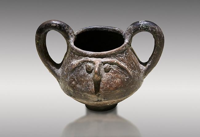 Hittite terra cotta double handled jug with a relief human face- 17th - 16th century BC - Hattusa ( Bogazkoy ) - Museum of Anatolian Civilisations, Ankara, Turkey . Against gray background
