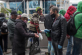 Obdachlose bekommen Essenl von Mitarbeitern von Sant'Egidio an der Bahnstation in Kiew / Homeless people get food from Sant'Egidio employees at the train station in Kiev.<br /><br /><br />Obdachlose in Kiew während der Corona Krise. Es gibt nach inofiziellen Schätzungen bis zu 20000 Obdachlose in der ukrainischen Hauptstadt. Viel stattliche Hilfe gibt es nicht, aber kleine Organisationen versuchen das nötigste zu organisieren. / Homeless in Kiev during the Corona crisis. According to unofficial estimates, there are up to 20000 homeless people in the Ukrainian capital. There is not much help, but small organizations try to organize the most necessary.