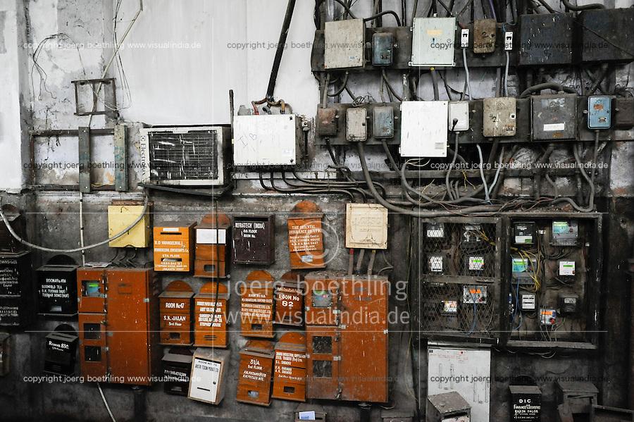 INDIA Kolkata, mail boxes and electric meter in old appartment building / INDIEN Kalkutta, Briefkasten, Stromzaehler in einem Wohnhaus