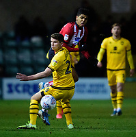 Lincoln City's Joe Morrell vies for possession with Milton Keynes Dons' Jordan Houghton<br /> <br /> Photographer Andrew Vaughan/CameraSport<br /> <br /> The EFL Sky Bet League One - Lincoln City v Milton Keynes Dons - Tuesday 11th February 2020 - LNER Stadium - Lincoln<br /> <br /> World Copyright © 2020 CameraSport. All rights reserved. 43 Linden Ave. Countesthorpe. Leicester. England. LE8 5PG - Tel: +44 (0) 116 277 4147 - admin@camerasport.com - www.camerasport.com