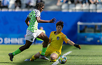 GRENOBLE, FRANCE - JUNE 12: Asisat Oshoala #8 of the Nigerian National Team beats Minjung Kim #18 of the Korean National Team and scores. during a game between Korea Republic and Nigeria at Stade des Alpes on June 12, 2019 in Grenoble, France.
