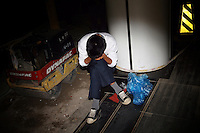 CHINA. Beijing. A man takes a rest in the shopping district of Xidan . 2008