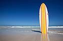 Retro surf board on beach