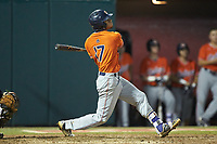 Will Holland (17) of the Auburn Tigers follows through on a solo home run against the Army Black Knights at Doak Field at Dail Park on June 2, 2018 in Raleigh, North Carolina. The Tigers defeated the Black Knights 12-1. (Brian Westerholt/Four Seam Images)