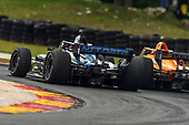 #10: Felix Rosenqvist, Chip Ganassi Racing Honda, #5: Pato O'Ward, Arrow McLaren SP Chevrolet, lead pass