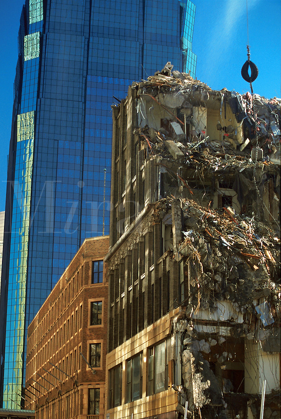 An old building in the process of being demolished. Concept - changes and growth leave no room for the past; out with the old, in with the new is the price of progess. Minnesota.