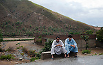 Two men sit by the side of the road in the troubled Buner District of Pakistan's North West Frontier Province. The Pakistani army claims to have driven the Taliban from the area and many people are leaving the refugee camps in Swabi and heading home. Reports of continuing Taliban presence in the area continue to surface however and it is clear the area is still far from safe and secure.