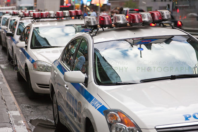 NYPD cars line 42nd Street between 6th and 7th Avenues during heightened security alert on September 10, 2011