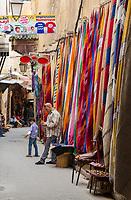 Fes, Morocco.  Fabric for Sale in Tala'a Seghira Street, in the Medina, Fes El-Bali.