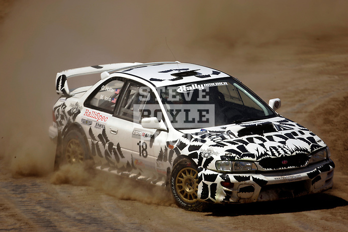 Driver Matt Iorio and co-driver Ole Holter come around a turn near the finish line while competing in the Rally Car Race finals during X-Games 12 in Los Angeles, California on August 5, 2006.