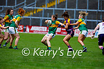Kerry's Anna Galvin under pressure from Shauna Murphy of  Wexford in the Lidl LGFA National football league game in Fitzgerald Stadium Killarney on Sunday.
