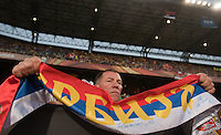 A Serbia fan holds a scarf at Loftus Versfeld Stadium during  the 2010 World Cup first round match between Serbia and Ghana in Pretoria, South Africa on Saturday, June 12, 2010.