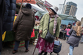 Woman shopping in Ridley Road market, Dalston, Hackney, London