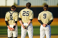Brett Armour (6), Matt Conway (25) and Austin Stadler (9) during the National Anthem prior to the game against the North Carolina State Wolfpack at Wake Forest Baseball Park on March 15, 2013 in Winston-Salem, North Carolina.  The Wolfpack defeated the Demon Deacons 12-6.  (Brian Westerholt/Four Seam Images)