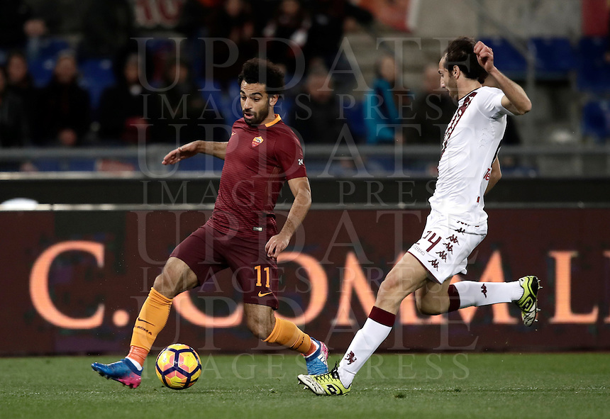 Calcio, Serie A: Roma, stadio Olimpico, 19 febbraio 2017.<br /> Roma's Mohamed Salah (l) in action with Torino's Emiliano Moretti (r) during the Italian Serie A football match between As Roma and Torino at Rome's Olympic stadium, on February 19, 2017.<br /> UPDATE IMAGES PRESS/Isabella Bonotto