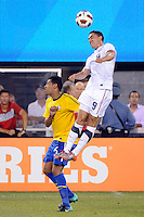 Herculez Gomez (9) of the United States goes over Andre Santos (6) of Brazil for a header. The men's national team of Brazil (BRA) defeated the United States (USA) 2-0 during an international friendly at the New Meadowlands Stadium in East Rutherford, NJ, on August 10, 2010.