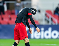 WASHINGTON, DC - APRIL 17: Brendan Hines-Ike #4 of D.C. United reacts to a missed shot during a game between New York City FC and D.C. United at Audi Field on April 17, 2021 in Washington, DC.