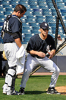 Feb 23, 2010; Tampa, FL, USA; New York Yankees manager Joe Girardi (28) talks to catcher Austin Romine (84) during  team workout at George M. Steinbrenner Field. Mandatory Credit: Tomasso De Rosa