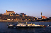 Bratislava, Slovakia. A boat on the Danube river, with Bratislava castle in the background.