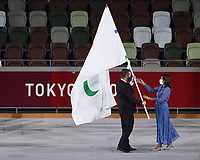 5th September 2021; Tokyo, Japan, 2020 Paralympic Games, closing ceremony:  Andrew Parsons L, president of the International Paralympic Committee IPC, passes the Paralympic flag to Anne Hidalgo, mayor of Paris