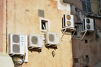- Corsica, Calvi, air conditioners on the wall of a house<br /> <br /> - Corsica, Calvi, condizionatori d'aria sulla parete di una casa