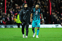Wayne Routledge supports Andre Ayew of Swansea City at full time during the Sky Bet Championship match between Brentford and Swansea City at Griffin Park in Brentford, England, UK. Thursday 26 December 2019