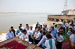 12 March 2013, Kanpur, Uttar Pradesh India: President of the World Bank, Mr Jim Yong Kim spesking with local expert at the Ganges River during his visit to the low income suburb of Gwaltoli on his tour of Kanpur in Uttar Pradesh state, India.The clean up of the river and its environs is a key project the World Bank in the area.  Mr.Kim is visiting India  for meetings with local staff, Indian Government Ministers and to inspect projects sponsored by World Bank in regional areas. Picture by Graham Crouch/World Bank