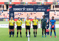 HOUSTON, TX - JUNE 13: Katja Koroleva and other officials stand before introductions during a game between Nigeria and Portugal at BBVA Stadium on June 13, 2021 in Houston, Texas.