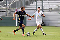 CARY, NC - AUGUST 01: Steven Miller #31 is defended by Jake Rufe #13 during a game between Birmingham Legion FC and North Carolina FC at Sahlen's Stadium at WakeMed Soccer Park on August 01, 2020 in Cary, North Carolina.