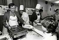 Montreal (QC) CANADA file photo - Dec 19 1987 - Robert Bourassa (L)_ and Jacques Chagnon, (RP) serve food at  Sun Youth