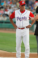 Stockton Ports manager Rick Magnante (2) meeting with the umpires before a game against the Visalia Rawhide at Banner Island Ballpark on August 15, 2015 in Stockton, California. Visalia defeated Stockton 9-1. (Robert Gurganus/Four Seam Images)