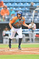 """Asheville Tourists Cody Orr (5) runs to first base after being walked during a game against the Aberdeen IronBirds on June 20, 2021 at McCormick Field in Asheville, NC. Tourists players were wearing jerseys for the """"Yacumamas de Asheville"""", as part of Minor League Baseball's """"Copa de la Diversion"""". (Tony Farlow/Four Seam Images)"""