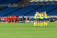 YOKOHAMA, JAPAN - AUGUST 6: Canada and Sweden huddle during a game between Canada and Sweden at International Stadium Yokohama on August 6, 2021 in Yokohama, Japan.