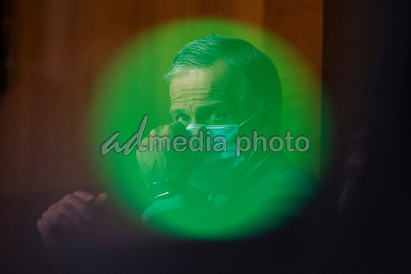 """United States Senator John Thune (Republican of South Dakota) adjusts his mask during a United States Senate Finance Committee hearing on """"COVID-19 and Beyond: Oversight of the FDA's Foreign Drug Manufacturing Inspection Process"""" at the US Capitol in Washington, DC on June 2, 2020.<br /> Credit: Andrew Caballero-Reynolds / Pool via CNP/AdMedia"""