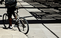 01 JUL 2014 - CHICAGO, USA - A cyclist waits for the lights to change at the Wells Street and West Wacker Drive junction in Chicago in the USA (PHOTO COPYRIGHT © 2014 NIGEL FARROW, ALL RIGHTS RESERVED)