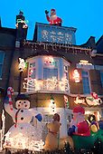 A house in West Hampstead, London, decorated with Christmas lights and figures