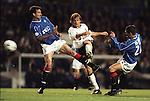 Mendieta beats Tony Vidmar and Derek McInnes to volley home Valencia's first goal at Ibrox, Champions League 1999