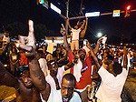 BATON ROUGE, LA -JULY 06:  Protesters block the intersection in front of  theTriple S Food Mart where Alton Sterling was shot and killed by police on July 5, 2016 in Baton Rouge, Louisiana. (Photo by Mark Wallheiser/Getty Images)