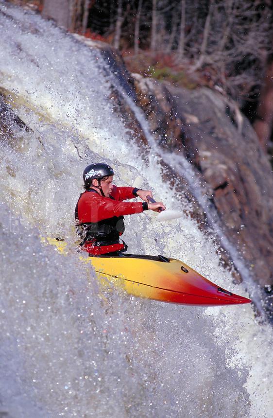 Whitewater kayak running Auger Falls on the Moose River. Lyons Falls New York United States Moose River - Adirondacks.