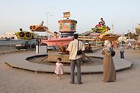Tripoli, Libya, North Africa - Children on Amusement Park Ride.