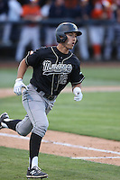 Mark Mathias (12) of the Cal Poly Mustangs runs to first base during a game against the Cal State Fullerton Titans at Goodwin Field on April 2, 2015 in Fullerton, California. Cal Poly defeated Cal State Fullerton, 5-0. (Larry Goren/Four Seam Images)