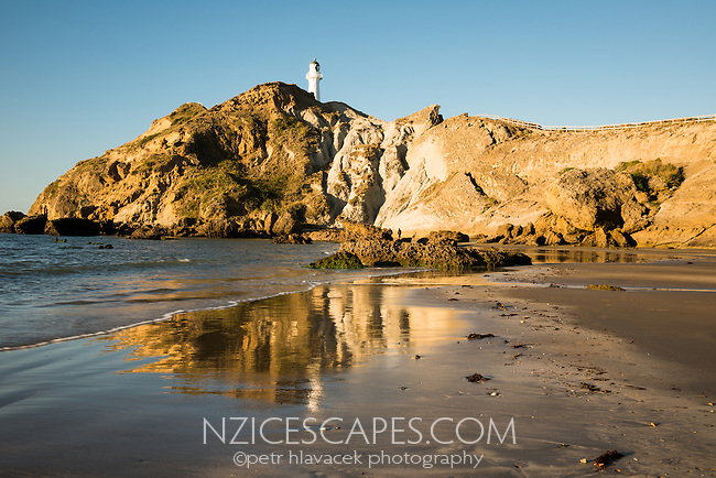 Evening light at Castlepoint with lighthouse, Hawke's Bay, North Island, New Zealand, NZ