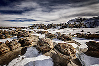 A light dusting of snow covers the ground in the Egg Garden at the Bisti Wilderness in New Mexico's San Juan Basin.