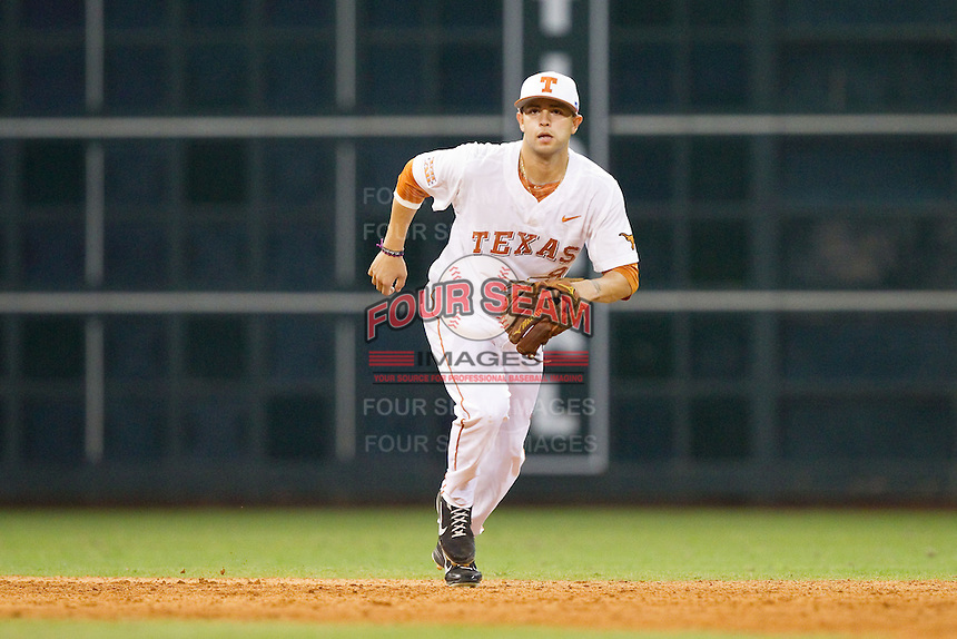 Texas Longhorns shortstop CJ Hinojosa #9 on defense against the Rice Owls at Minute Maid Park on February 28, 2014 in Houston, Texas.  The Longhorns defeated the Owls 2-0.  (Brian Westerholt/Four Seam Images)