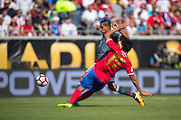 Orlando, Florida - Saturday, June 04, 2016: Paraguayan defender Jorge Benitez (7) tries to avoid the tackle by Costa Rican midfielder Yeltsin Tejeda (17) during a Group A Copa America Centenario match between Costa Rica and Paraguay at Camping World Stadium.