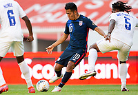 GUADALAJARA, MEXICO - MARCH 28: Sebastian Saucedo #10 of the United States takes a shot during a game between Honduras and USMNT U-23 at Estadio Jalisco on March 28, 2021 in Guadalajara, Mexico.