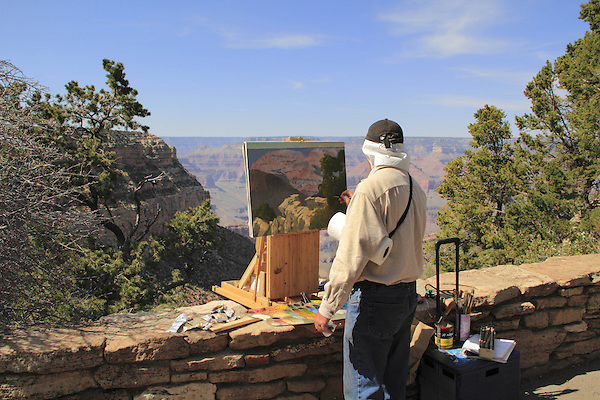 Artist painting a landscape along the South Rim of Grand Canyon National Park, northern Arizona, USA . John offers private photo tours in Grand Canyon National Park and throughout Arizona, Utah and Colorado. Year-round.
